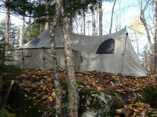 "This hunter's ""drop camp"" was established back in the woods atop a large glacial erratic. (Photo — Joe Hackett)"