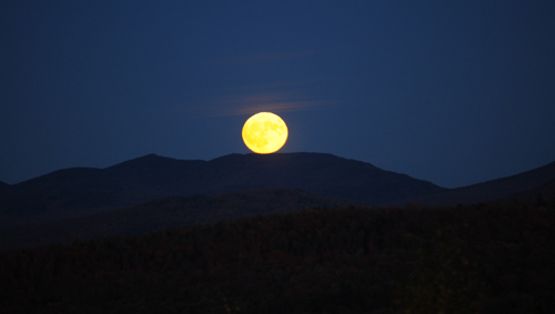 "The ""hunter's moon"" rises over the mountains on Oct. 15. A historic supermoon will be in the sky Sunday and Monday. (Enterprise photo — Lou Reuter)"