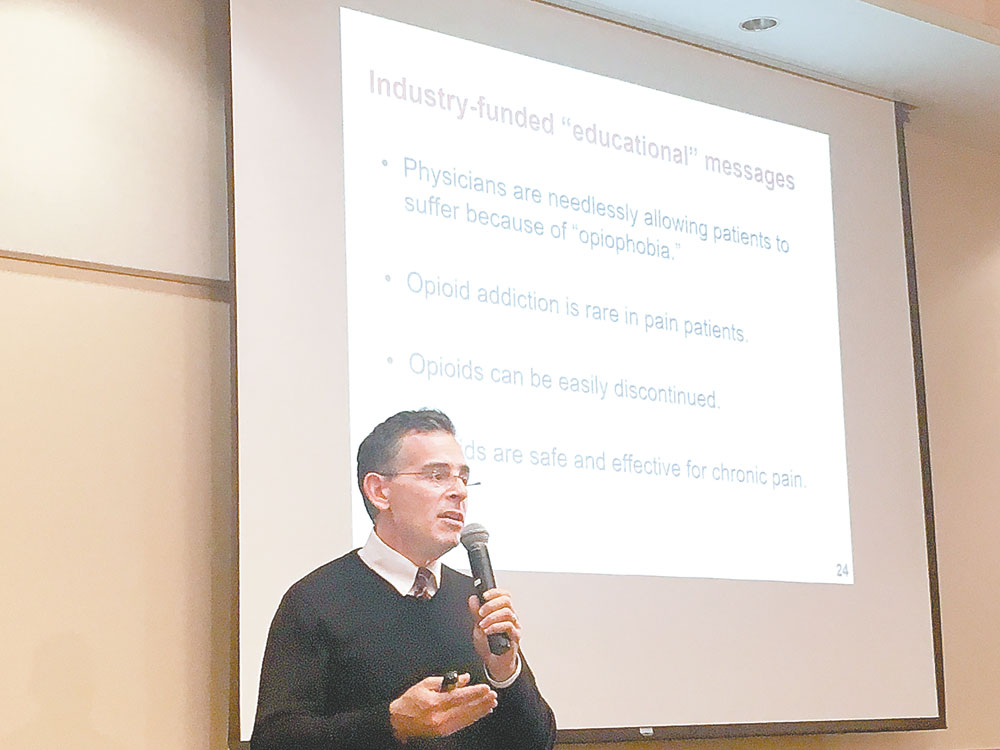 Andrew Kolodny, an expert on the heroin and opioid epidemic, speaks at a forum on the issue at the Conference Center at Lake Placid Friday that was attended by many local doctors, dentists and educators. (Enterprise photo —Antonio Olivero)