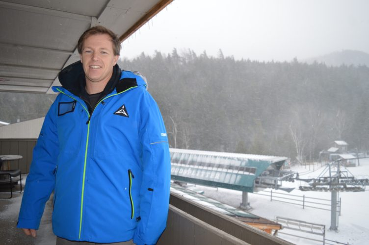 Whiteface Mountain Ski Center General Manager Aaron Kellett stands on the balcony outside his office overlooking the mountain during Monday's Winter Storm Argos, days before Whiteface opens Friday. (Enterprise photo —Antonio Olivero)