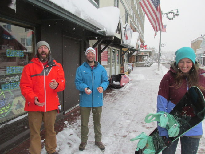 ... and just can't hide it. The recent snowstorm brought plenty of smiles to skiing and snowboarding enthusiasts, especially along Main Street in Lake Placid. Pictured, Cory Keysor, left, and Tyler Merriam sport new ski jackets and enjoy the falling snow right in front of the Lake Placid Ski & Board Shop, as Alyssa Gentzler, right, shuffles by with snowboard in hand. The trio said they anticipate a snowy winter and plan to spend lots of time on the slopes at Whiteface Mountain. (Photo provided)