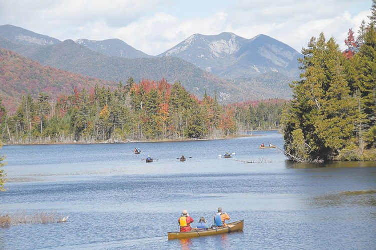Paddlers venture out on Boreas Ponds, with views of the High Peaks in the background. (Enterprise photo — Mike Lynch)
