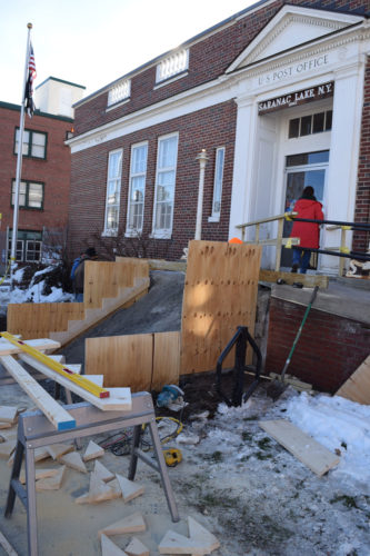 A crew from Dow Electric of Malone has started work on replacement of the Saranac Lake Post Office front steps. (Enterprise photo — Chris Knight)