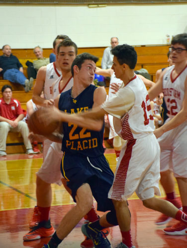 Lake Placid's Max Menkel fights for a rebound under the Saranac Lake basket during Wednesday night's game in Saranac Lake. (Enterprise photo — Justin A. Levine)