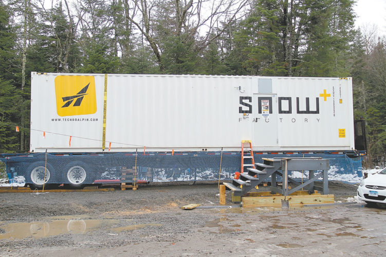 "As seen on Tuesday, this Snow Factory — manufactured by TechnoAlpin — was recently delivered to the Olympic Sports Complex cross-country ski lodge at Mount Van Hoevenberg. The ski center's nordic program manager, Kris Cheney Seymour, declined to comment about the machine at that time. The facility has not had snowmaking capabilities in the past; therefore, the Snow Factory could potentially be a game changer for the state Olympic Regional Development Authority as it markets the ski center for community skiing, tourism and competition. Last winter, the trails were only open for 37 days due to unseasonably warm temperatures. According to the TechnoAlpin website, the Snow Factory offers ""a snow-making system for use at above-zero temperatures."" Traditional snowguns need temperatures of 28 degrees or below to work. The facility's Facebook page featured photos of its first pile of artificial snow on Thursday. (Enterprise photo — Andy Flynn)"