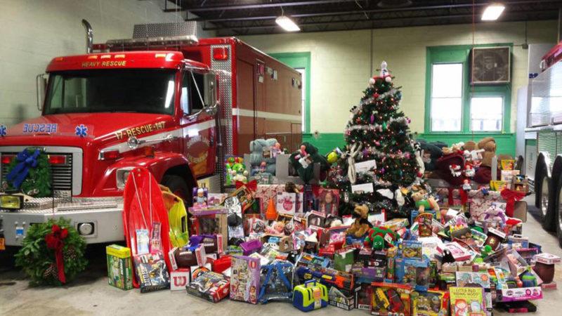 Donated toys are gathered Saturday at the Saranac Lake Volunteer Fire Department. (Photo provided — Eva Stinson)