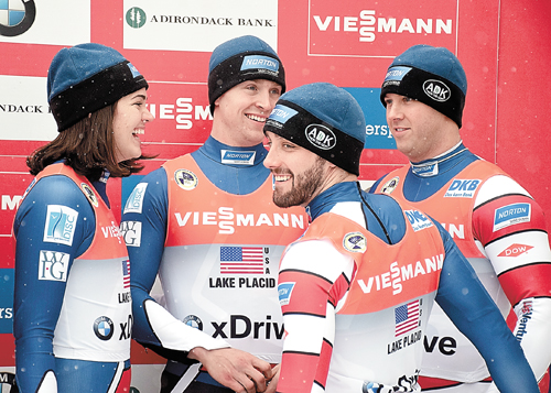 From left, Summer Britcher, Tucker West, Jayson Terdiman and Matt Mortensen react after claiming the bronze medal in Saturday's World Cup luge team relay at Mount Van Hoevenberg outside of Lake Placid. The race consists of a combined time for the top woman, man and double's team from each country. (Enterprise photo — Justin A. Levine)