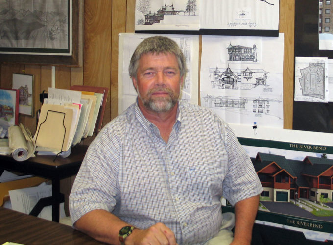 James Morganson, code enforcement officer and building inspector for the town of North Elba and village of Lake Placid, sits in his office in 2006. (Enterprise photo — Rebecca Steffan)