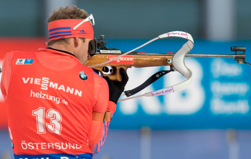 Lowell Bailey takes a shot from the standing position Sunday in Oestersund, Sweden. (Photo — NordicFocus/US Biathlon)