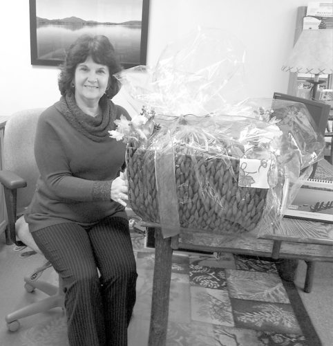 Brenda Clark, left photo, wins the Saranac Lake Women's Civic Chamber Thanksgiving basket raffle. (Photo provided)