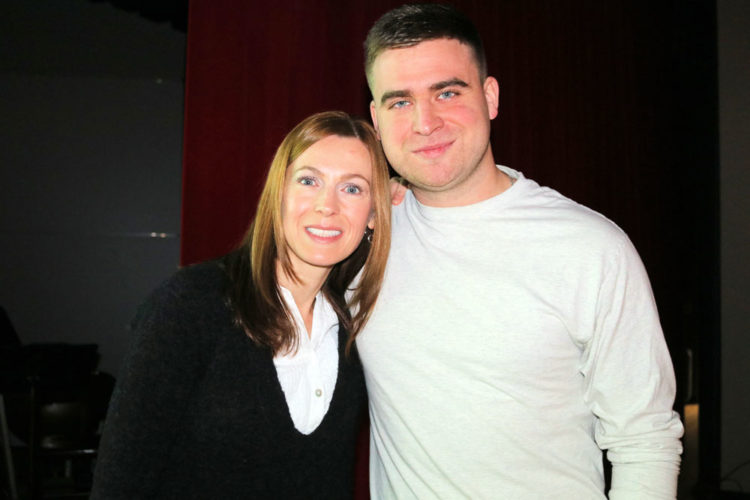 David Benham, right, poses with his former high school art teacher, Jen Moore, who helped facilitate a presentation he made at his alma mater, Saranac Lake High School, on Nov. 21. A member of the SLHS Class of 2010, Benham later graduated from Pratt Institute in New York City and is currently an art director at MTV. The assembly focused on career opportunities for students in the visual and creative arts. (Photo provided)