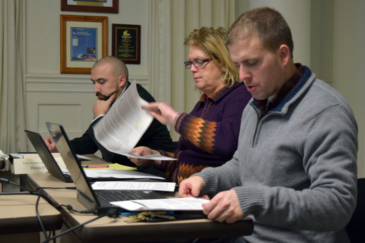 Saranac Lake Community Development Director Jeremy Evans, right, speaks during Tuesday night's village Planning Board meeting. Listening are board members C.J. Hagmann, left, and Donna Difara. (Enterprise photo — Chris Knight)