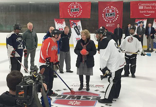 State Sen. Betty Little drops the ceremonial ball Wednesday in the Malone Civic Center to mark the addition of broomball to the Empire State Winter Games lineup. (Photo courtesy of ESWG)