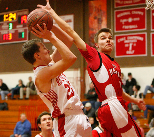 Saranac Lake senior Joe Viscardo drives to the basket for two of his team-high 18 points as Max Longware of Willsboro defends during Wednesday night's game at Saranac Lake High School. (Photo — Roy Bombard)