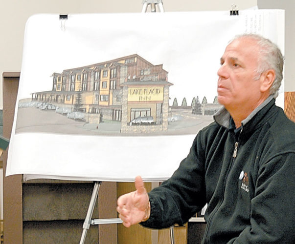 Local businessman Paolo Magro presents his plan for a 42-room boutique hotel at the site of the former National Sports Academy school, 821 Mirror Lake Drive, at Wednesday's Lake Placid-North Elba Joint Review Board meeting at the North Elba Town Hall in Lake Placid. (Enterprise photo — Antonio Olivero)