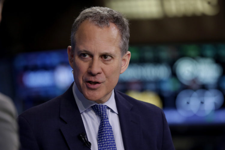 New York Attorney General Eric Schneiderman is interviewed on the floor of the New York Stock Exchange Aug. 21, 2014. (AP photo — Richard Drew)