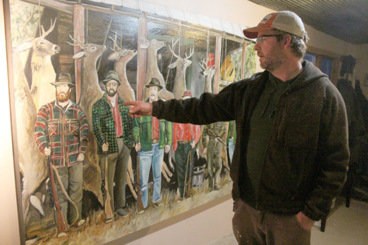 Matt Burnett talks about one of his paintings in November 2013. (Enterprise photo — Shaun Kittle)