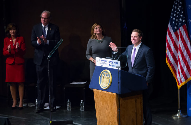 Gov. Andrew Cuomo speaks at the 2016 Regional Economic Development Council awards ceremony Thursday at the Egg in Albany. Broadcast journalist Maria Bartiromo, center, announced each of the award winners. (Photo provided by the governor's office)