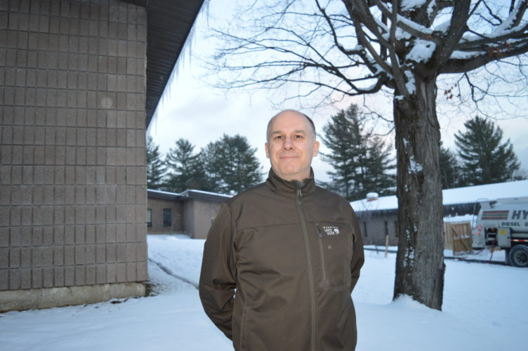 Joe Pete Wilson Jr. stands on the campus of North Country Community College in Saranac Lake, where he currently works as coordinator of the Learning Assistance Center. He will leave that job, as well as his post on the Keene school board, to become Keene town supervisor full time. (Enterprise photo — Antonio Olivero)