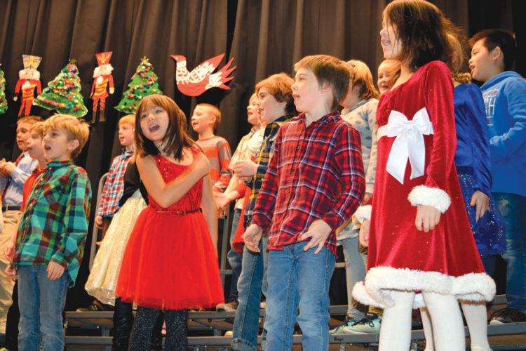 "Third-grade students at Petrova Elementary School in Saranac Lake perform ""Hot Cup of Cocoa"" during the school's Winter Concert for grades 3, 4 and 5 Friday. The students put on two shows to packed houses in the school's auditorium: one at 10 a.m. and another at 7 p.m. (Enterprise photo — Chris Knight)"