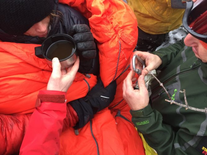 Madison Popolizio receives a cup of hot tea and assistance from search crews after she and her boyfriend spent two unplanned nights near the top of Algonquin Peak.  (Photos provided by the state Department of Environmental Conservation)