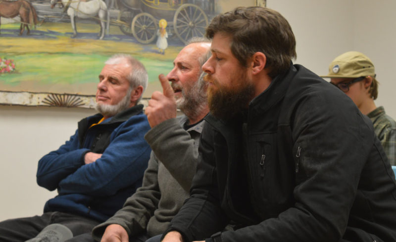 Mirror Lake dogsled operators John Houghton of Thunder Mountain Dogsleds of Vermontville, center, speaks to the LakePlacid Village Board Monday night with Michael, left, and A.J. Arnold, right, of ADK Wilderness Adventures of Saranac Lake. (Enterprise photo —Antonio Olivero)