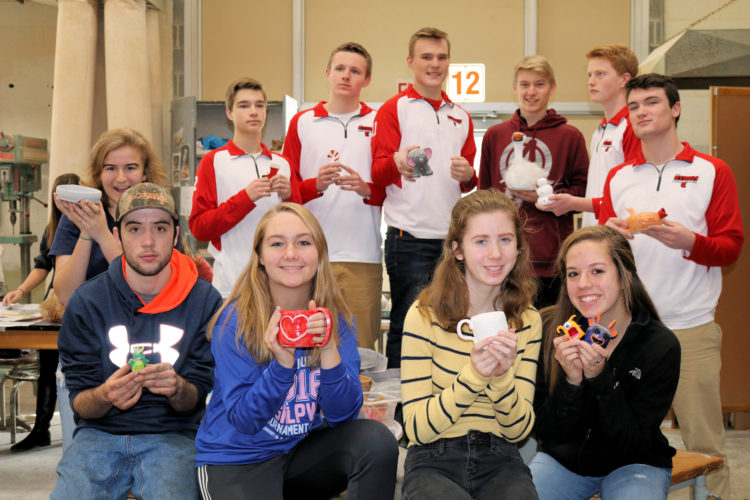 Pictured are the ceramics class at Saranac Lake High School: (back row, from left): Erika Swirsky, Emery Swanson, Emmett Bevilacqua, Jarrett Ashton, Wyatt Foley, Ethan Paye and Ward Walton; (front row, from left) are Tanner Courcelle, Makayla Schmidt, Kaylee McLean and Kiki Walker. (Photo provided)