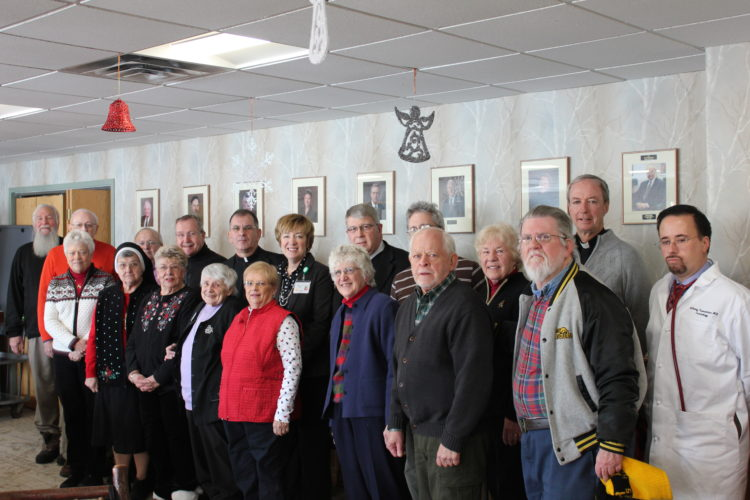 Attendees of the annual Tri-Lakes Ministry and Clergy Summit pose for a photo with Adirondack Health President and CEO Sylvia Getman, back row sixth from left, and Dr. Anthony Tramontano, far right, in the hospital's Redfield Board Room. (Photo provided by Adirondack Health)