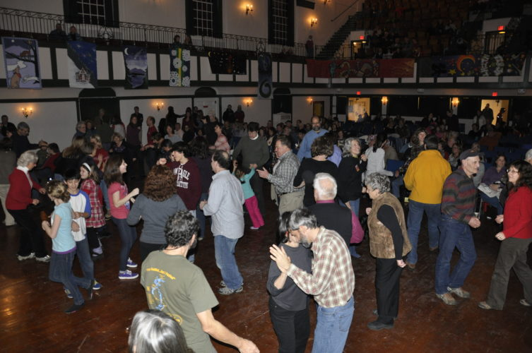 People dance at First Night Saranac Lake in the Harrietstown Town Hall auditorium. (Photo provided — Nancy LaBombard)