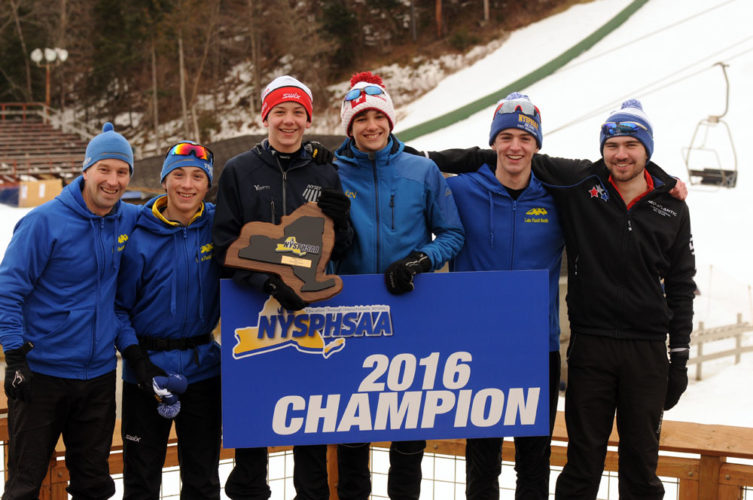 The Lake Placid high school nordic ski team celebrates its state championship title in February at the Olympic Ski Jump Complex in Lake Placid. From the left are coach Bill Frazer, Henry McGrew, James Flanigan, Jesse Izzo, Scott Schulz and Patrick Broaderick.		              (Enterprise photo — Lou Reuter)