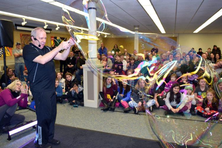Jeff Boyer performs a bubble show at the Saranac Lake Free Library Saturday night at First Night Saranac Lake. (Enterprise photo — Chris Knight)