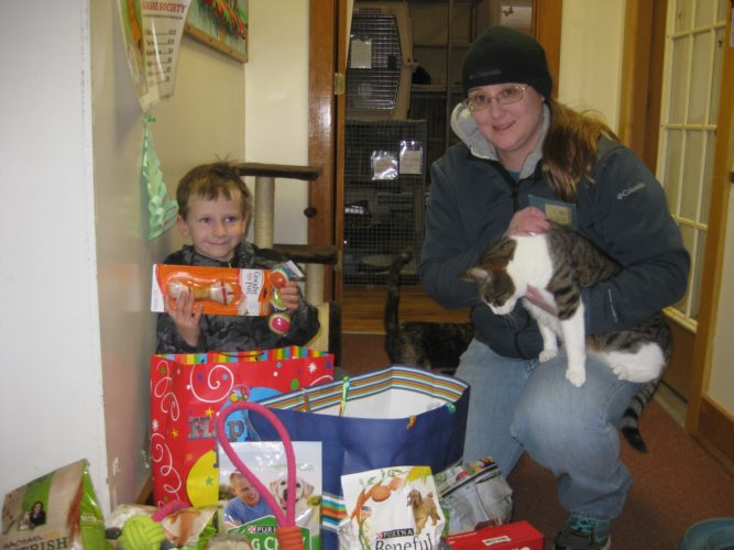 For his sixth birthday, Mason Anthony Estling had friends bring donations for the Tri-Lakes Humane Society to his party. He  collected more than$60, four food items for dogs, 10 food items for cats, seven toys and nine types of treats.  He is  pictured with Tri-Lakes Humane Society Director Lena Bombard.  (Photo provided)