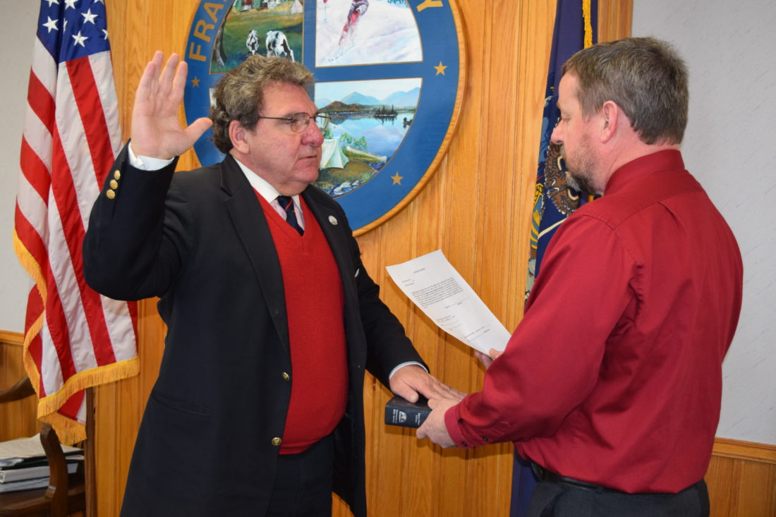 Franklin County Legislator Paul Maroun of Tupper Lake, who won another term in the November election, takes the oath of office Thursday from Franklin County Clerk Kip Cassavaw. (Enterprise photo -- Chris Knight)
