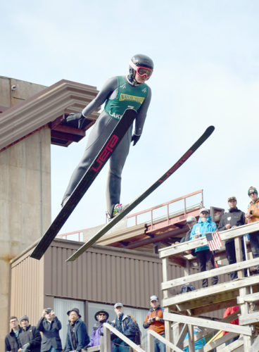 Lake Placid's Gabby Armstrong launches off the 90-meter jump during the National Ski Jumping Championships at the Flaming Leaves Festival in Lake Placid on Oct. 9. Armstrong took third in the competition. (Enterprise file photo — Justin A. Levine)