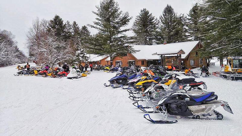 Snowmobiles are parked outside Norridgewock III in Beaver River. (Photo provided)