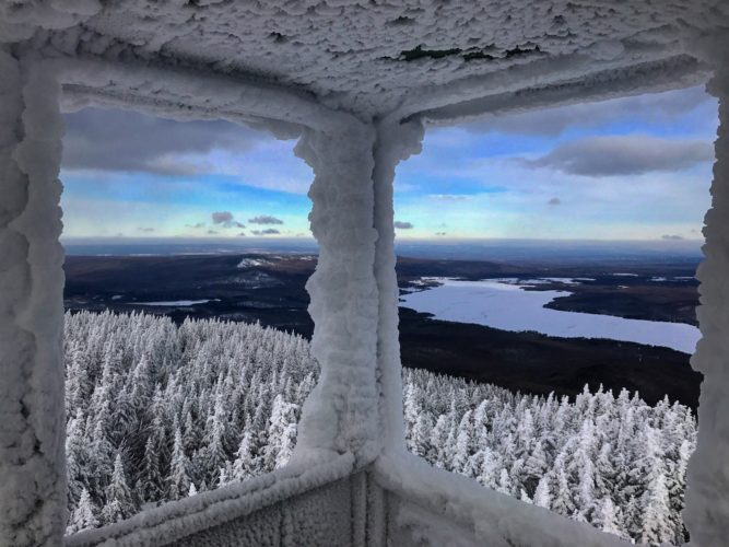 Chazy Lake is seen from the snow-covered fire tower atop Lyon Mountain Saturday. At an elevation of 3,830 feet, it is the highest point in Clinton County and the highest point north of the Saranac River. (Photo provided — Shawn Turner)