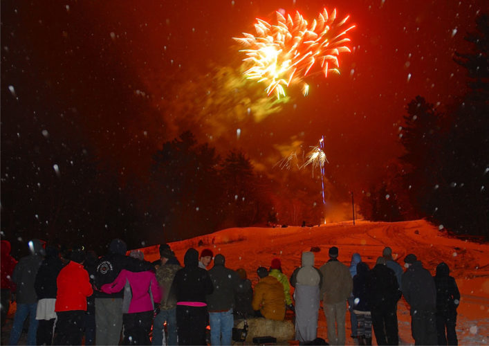 Fireworks shoot off over Mount Sabattis during the 2016 Long Lake Winter Carnival. (Photo provided)