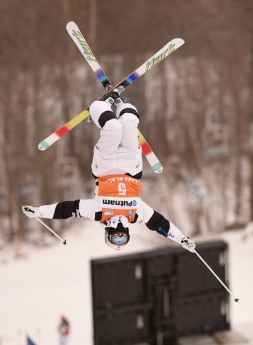 A competitor performs a move during their moguls run at the 2015 World Cup freestyle event at Whiteface Mountain in Wilmington. The competition returns to the area Friday and Saturday at Whiteface and the Olympic Jumping Complex. (Enterprise file photo — Lou Reuter)
