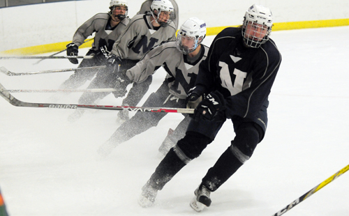 Players on Northwood's Junior teams work out on the ice at the Olympic Center's 1932 Rink during a practice session on Tuesday. The Huskies take on Shattuck-St. Mary's today at 5 p.m. in a Northwood Invitational showdown. (Enterprise photo — Lou Reuter)