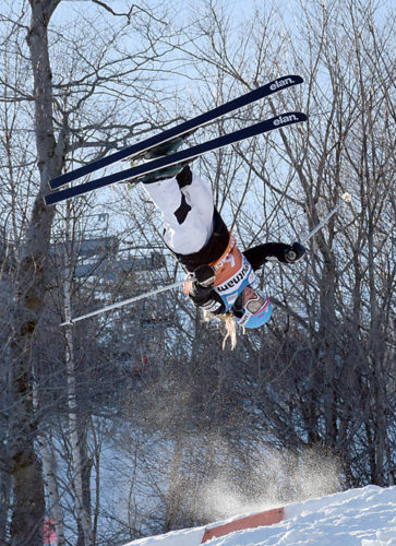Morgan Schild flies high through the air during the World Cup moguls competition Friday afternoon at Whiteface Mountain in Wilmington. Schild captured a bronze medal in the event. (Enterprise photo — Justin A. Levine)