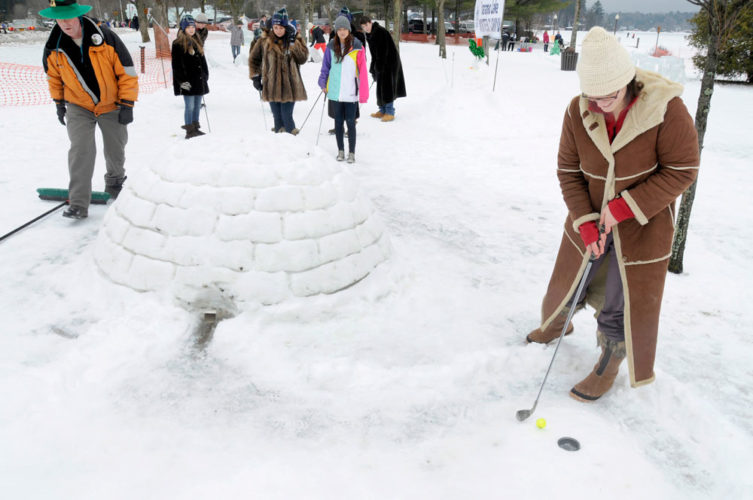 Contestants play Arctic Golf as part of the Saranac Lake Winter Carnival. (Photo provided — Mark Kurtz)