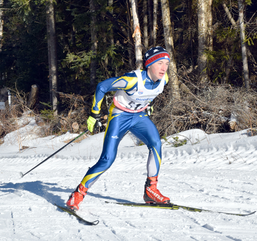 Lake Placid senior Henry McGrew built a sizable lead by powering up the hills at Mount Van Hoevenberg on Monday morning during the first Section VII Invitational. McGrew finished first overall in the race. (Enterprise photo — Justin A. Levine)