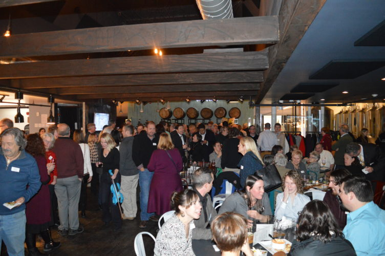 Attendees of the Regional Office of Sustainable Tourism gather at the Big Slide Brewery and Public House in Lake Placid Monday during ROOST's Winter Social. (Enterprise photo — Antonio Olivero)