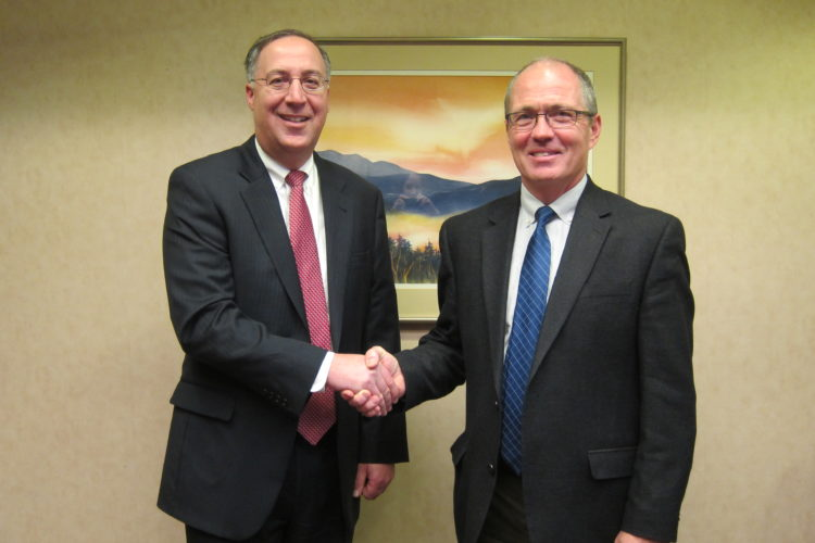 Champlain National Bank President and CEO Steven Cacchio, left,  and Community Hospital President John Remillard (Photo provided)