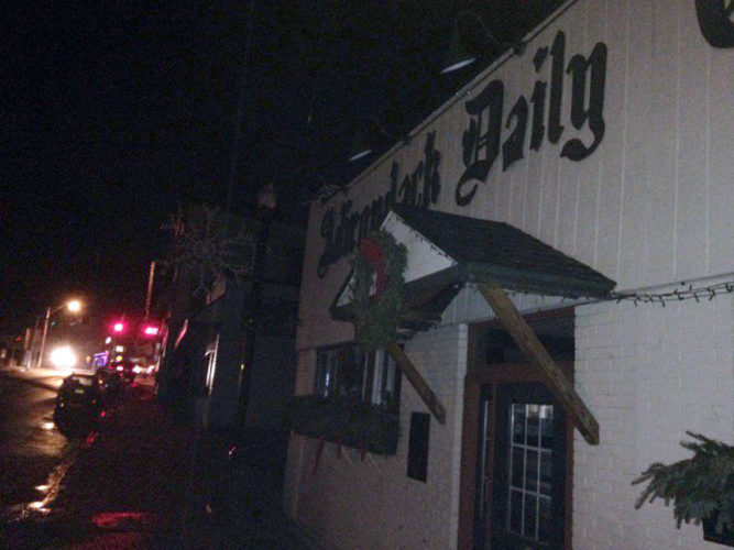 Electricity is out Tuesday evening on the side of Broadway where the Adirondack Daily Enterprise office is located in Saranac Lake, but not on the other side or at the stoplight in the background. (Enterprise photo — Peter Crowley)