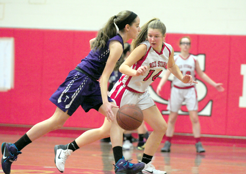 Saranac Lake's Roslyn McClatchie plays intense defense against Ticonderoga's Delaney Hughes during Wednesday's game in Saranac Lake. The Red Storm limited Hughes, on the the CVAC's top scorers, to nine points. (Enterprise photo — Lou Reuter)