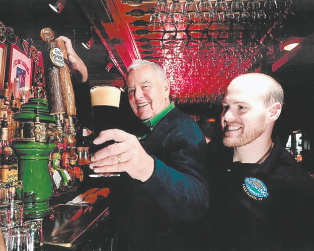 Ed Kane, the founder of Great Adirondack Steak & Seafood Co., and Great Adirondack Brewing Co., is seen here making a toast inside the Main Street establishment he bought 35 years ago. (Photo provided — The Kane family)