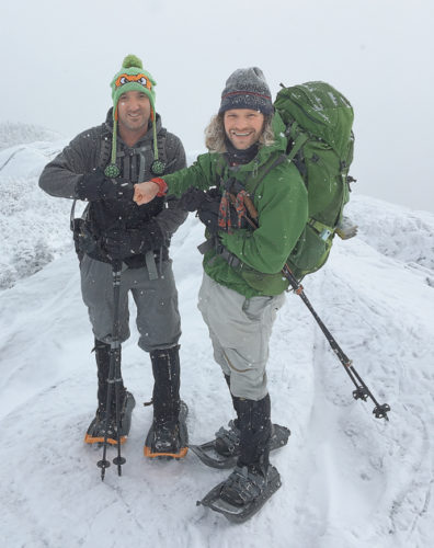 Rob Van Avery, left, fist-bumps Adirondack Mountain Club Wilderness trip leader Tyler Socash after successfully summiting Wright Peak as part of Winterfest on Jan. 7. (Photo provided — Rob Van Avery)