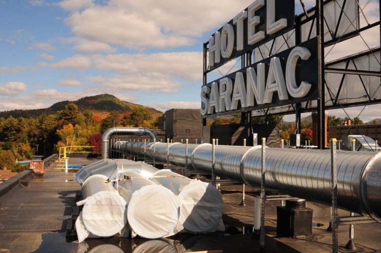 The sign atop the Hotel Saranac is seen from its rooftop in October 2016.  (Enterprise photo — Lou Reuter)