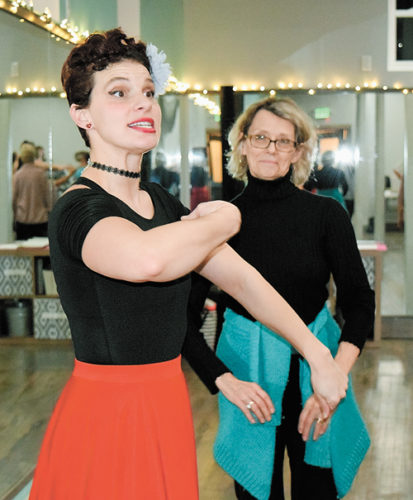 Vanessa Pillen, co-founder of the Dance Sanctuary in Saranac Lake, is dressed for the part as she instructs a salsa class. (Enterprise photo — Chris Knight)